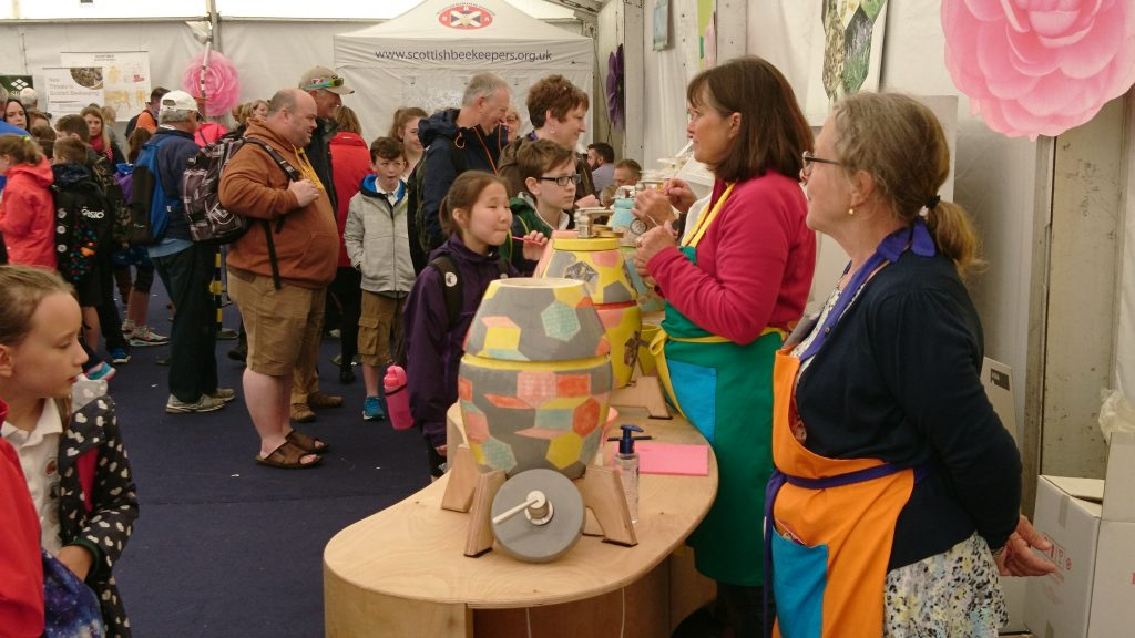 Royal Highland Show, 2017. Lorraine Russell (on right), Fife member, helping out with honey tasting