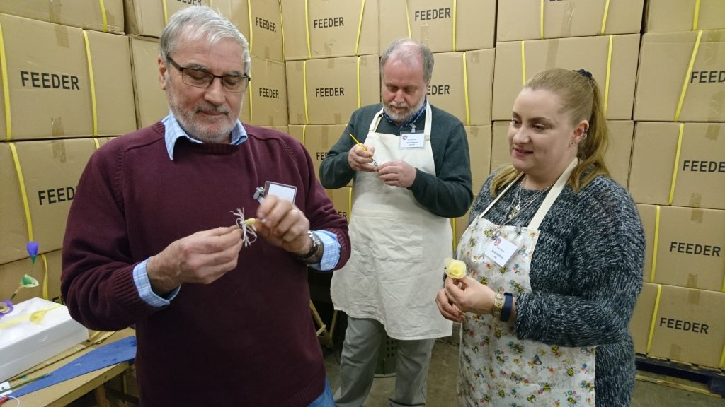 SBA Wax Workshop, 2017. Jeff Baxter, Dunfermline (left) and daughter Karen with Gavin Ramsay (centre) making beeswax flowers